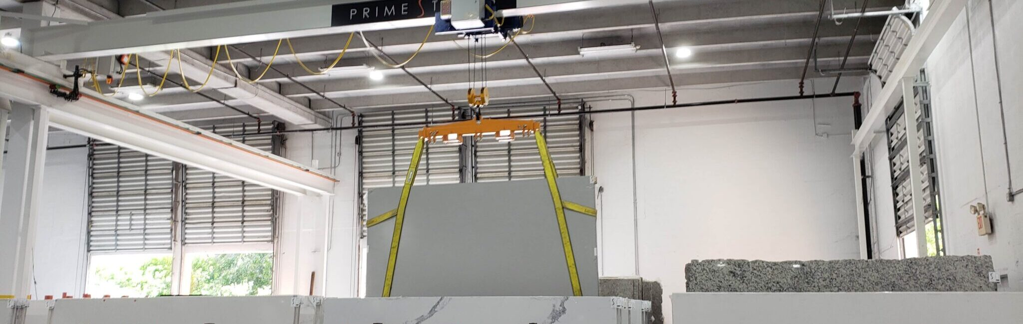 Overhead Crane manufactured by Material Handling Systems, Inc. (MHS CRANE) picking up a marble slab with lifting slings
