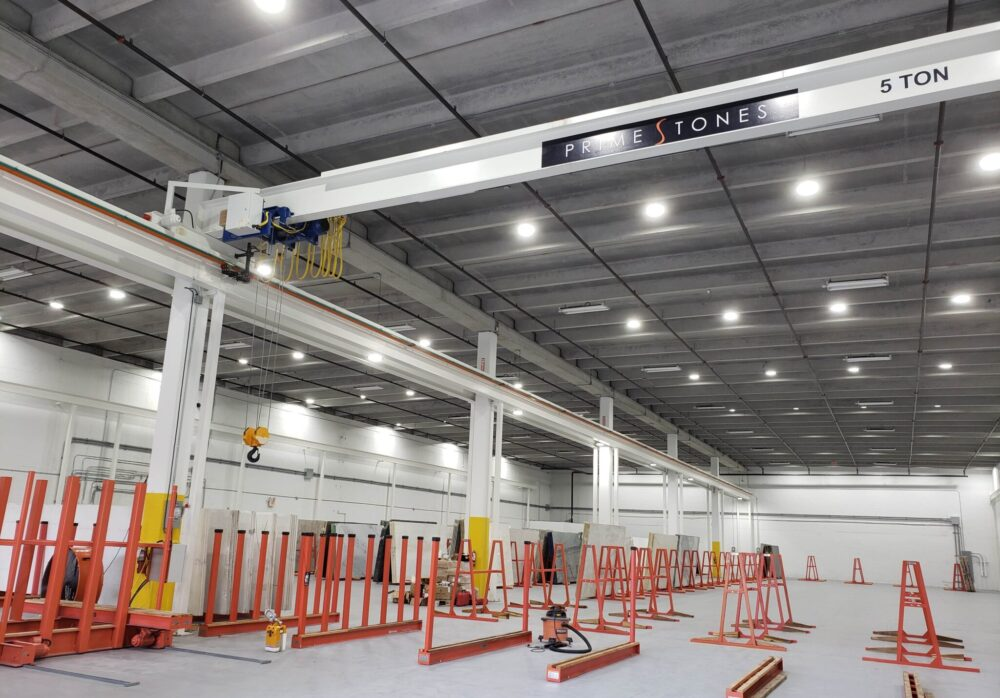 Customized Overhead crane, festoon system, runways and support beams manufactured by Material Handling Systems, Inc. (MHS CRANE) and installed at marble, granite and stone facility at Primestones